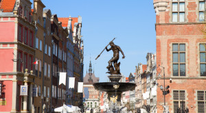 The Neptune fountain, bronze statue of the Roman God of the Sea in old town of  Gdansk (Danzig), Poland