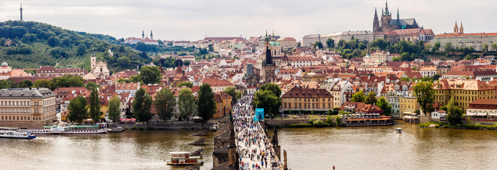 PRAGUE, CZECH REPUBLIC - JUNE 11: Tourists on Charles Bridge, June 11, 2013, Prague,Czech Republic. Annually Prague is visited by more than 3,5 million tourists